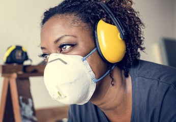 Black woman wearing ear protection Wall mural