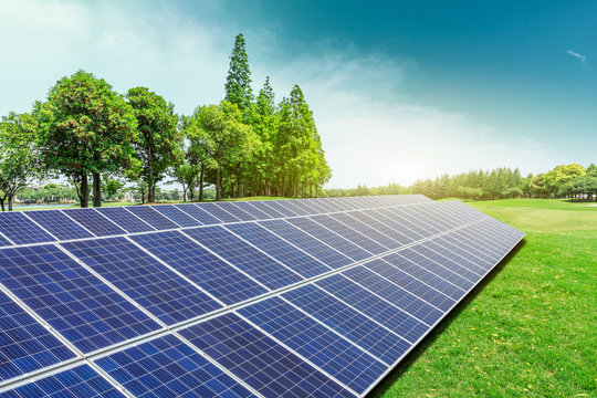 Solar panels and trees natural scenery,green energy concept