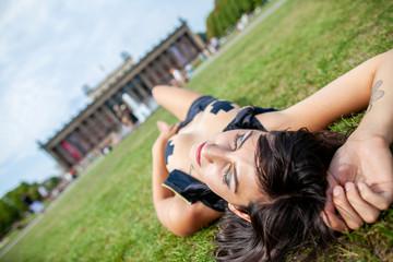 Sexy girl lies on gras at Lustgarten in Berlin