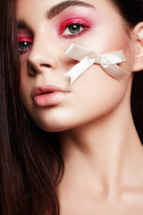Beautiful Girl with makeup and silk bow