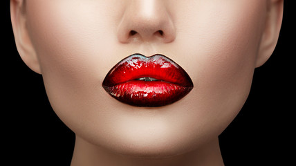Lips makeup. Beauty high fashion gradient lips makeup sample, black with red color. Sexy mouth closeup. Lipstick