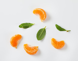 segments and leaves of ripe tangerine