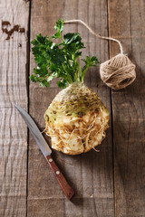 Fresh celeriac root on rustic wooden background