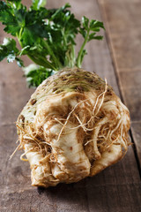 Close up image of celeriac root on rustic wooden background