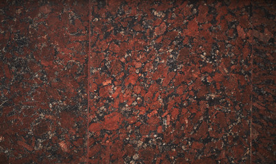 Polished red granite texture