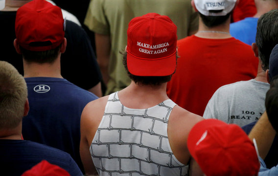 People listen in the crowd as U.S. President Donald Trump holds a Make America Great Again rally in Olentangy Orange High School in Lewis Center