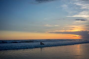 couple on beach at sunset, romantic mood