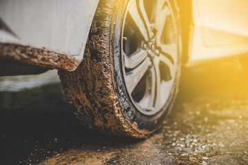 Close up of mud car tires with warm colors. Wall mural