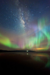Milkyway with beautiful aurora Borealis. soft focus and noise due to long expose and high iso.