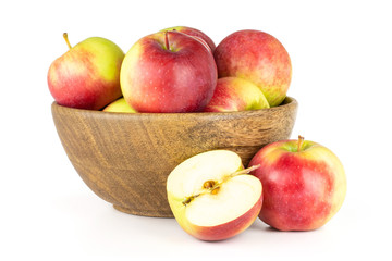Lot of whole one half of fresh red apple james grieve variety with wooden bowl isolated on white background