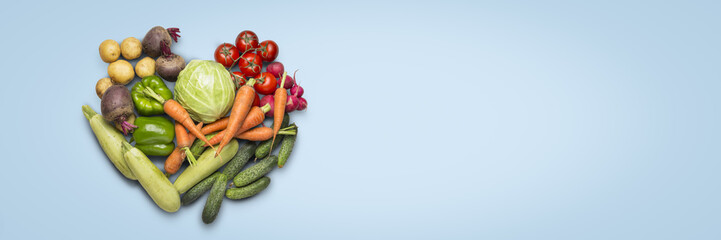 Fresh organic vegetables on a blue background. Concept of buying