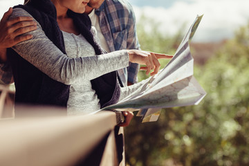 Couple looking for travel destination on map