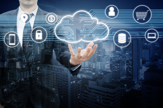 Double exposure of professional businessman connected and presented Cloud technology and internet of things and wireless network with blue tone background , business and technology concept