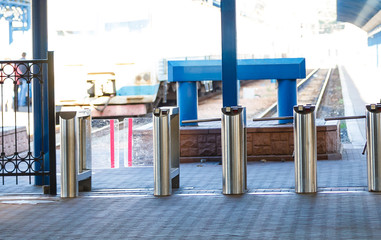 Closed entrance turnstile with access denied red sign. Security barrier