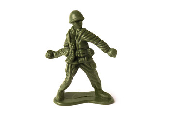 Toy soldier throwing a grenade bomb, isolated on white background