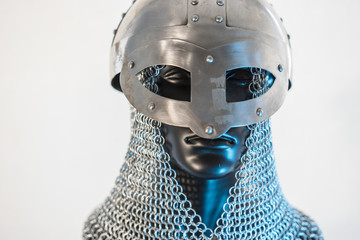 Viking helmet with chain mail in a black mannequin on white background. clothes for the viking war