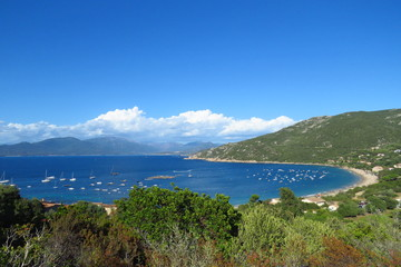 Campomoro beach, a deep blue sea and white sand surrounded by green hills, Corsica, France
