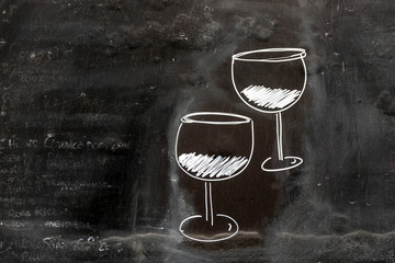 Two glasses of wine drawn on blackboard