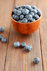 Fresh Ripe Garden Blueberries in a Cup on Wooden Background