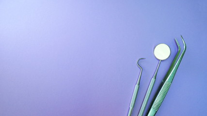 Basic dentist tools isolated on purple or violet background