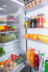 Open fridge full of fresh food products