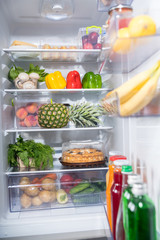 Fresh food abundance in open fridge
