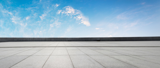 Clean square floor and blue sky with white clouds
