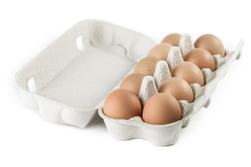 Open box full of eggs, isolated on white background