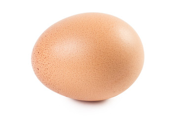 Close-up view of a brown egg with freckles, isolated on white background
