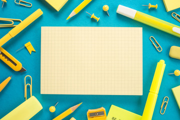 School office supplies on a blue background