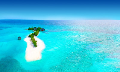 Wall Mural - Islands and turquoise ocean from above