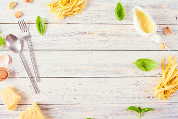 Pasta background. Dry pasta with vegetables, mushrooms, cheese and herbs.