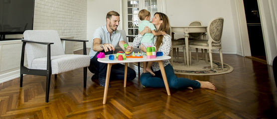 Happy family playing in the living room