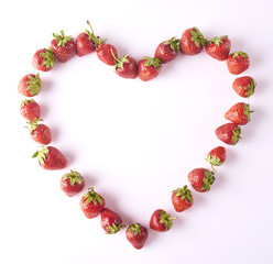 Heart made with freshly harvested strawberries isolated