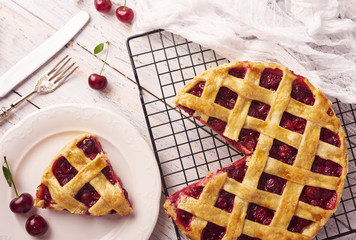 Piece of Delicious Homemade Cherry Pie with a Flaky Crust on rustic