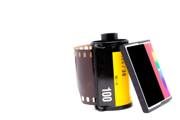 Photograph of 135 negative films and the modern memory card (CF Card) isolated on white background.