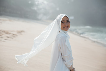 portrait of asian muslim woman in white