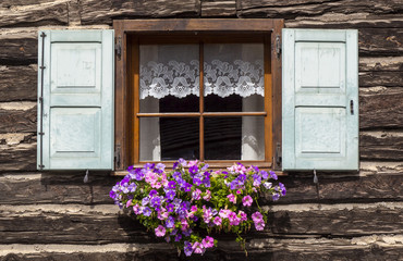 Traditional flowered windows at the Italian Alps and dolomites