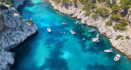 Yachts at the sea in France. Aerial view of luxury floating boat on transparent turquoise water at sunny day.