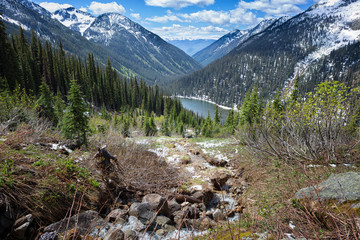 Gibson Lake in Kokanee Glacier Park, British Columbia, Canada. Shot from above. Snow covered mountains.