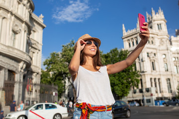 attractive young woman taking a selfie in Madrid, Spain