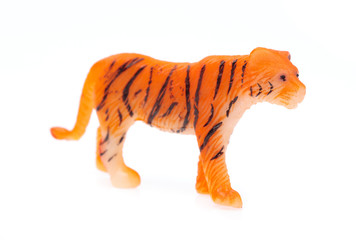 toy plastic tiger isolated on white background