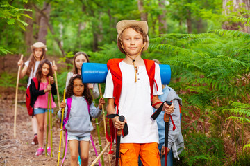Boy portrait in group of friends hiking