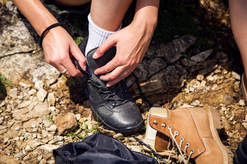 Close up woman tying hiking boots