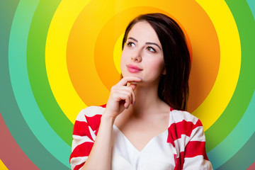 portrait of the beautiful young woman on rainbow background