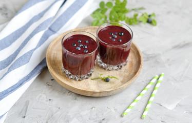 Delicious wild blueberry smoothie milk yogurt ice cream gray background summer drink concept