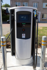 Charging station for electric vehicles, electro car charging station on gas station.