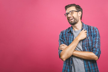 Portrait of a handsome casual man who laughs, standing and laughing over pink background Wall mural
