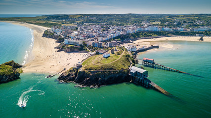 Aerial drone view of a picturesque and colorful coastal holiday town (Tenby, UK)