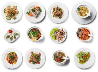 Rich collection of vietnamese dishes, view from above, isolated on white background